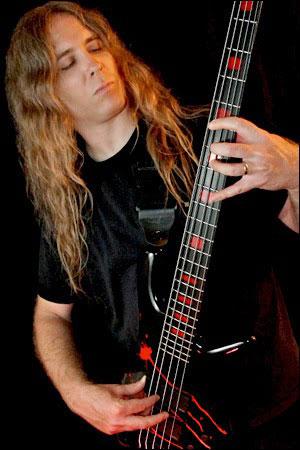 Alex Webster playing bass