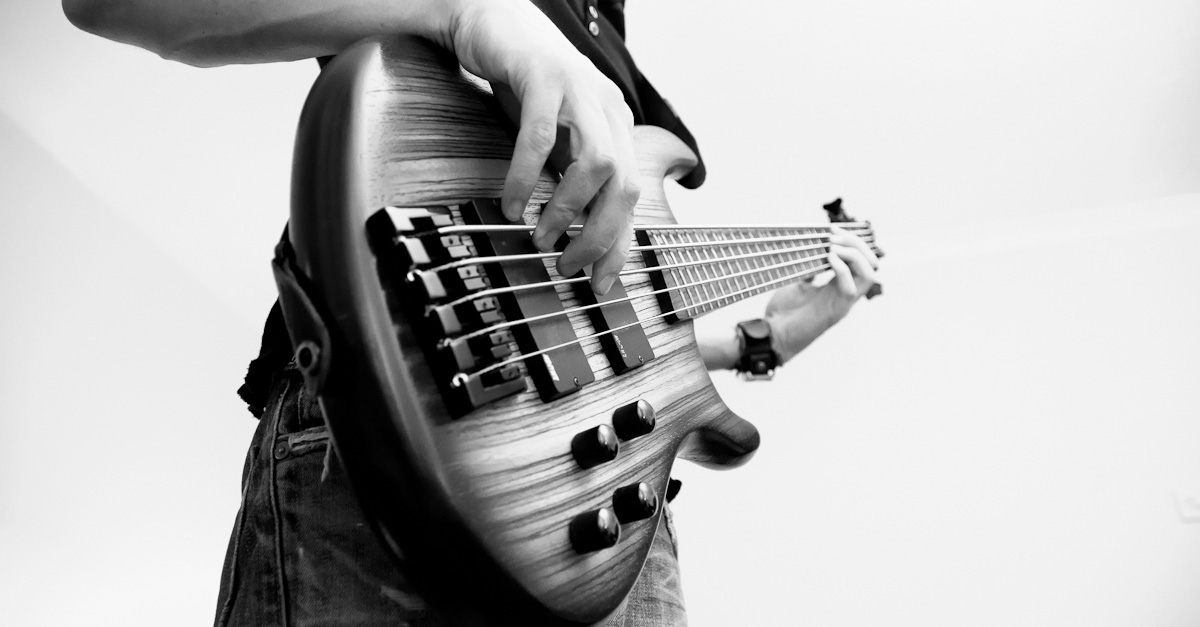 Bass player by Adam Browning